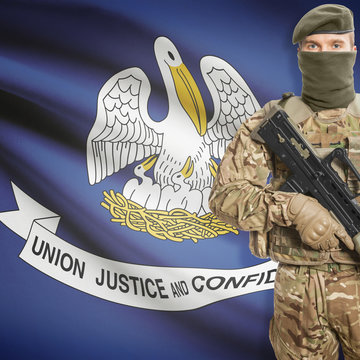 Soldier with machine gun and USA state flag on background - Louisiana