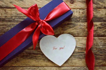 holiday blue gift box and white heart