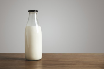 Antic blank bottle with milk on table