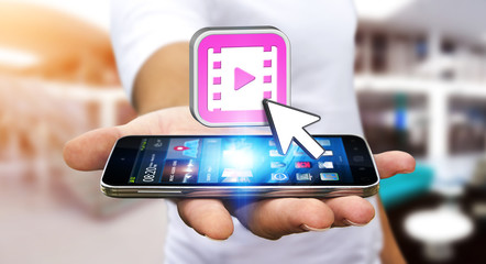 Young man using modern mobile phone to watch video