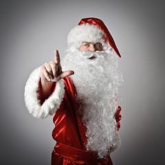 Santa Claus pushing the button