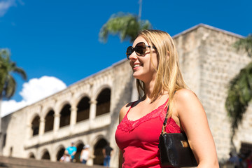 Blonde girl smiling at Alcazar de Colon in Santo Domingo, Dominican Republic