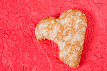 gingerbread heart cookie on red background