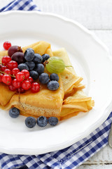 crepes with berries on plate