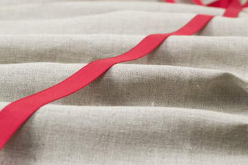 Red tape on a linen cloth