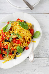 pasta with roasted tomatoes on white plate