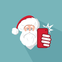 Santa Claus taking photo of himself by his phone