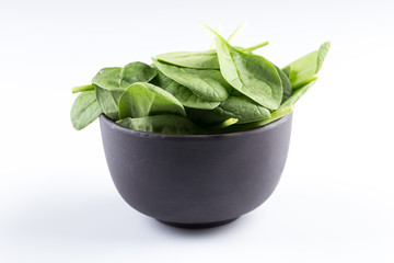 Green spinach on a white background