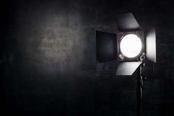 Lighting equipment on a black background old shabby wall