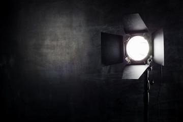 Fotobehang Licht, schaduw Lighting equipment on a black background old shabby wall
