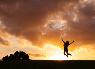 Woman jumping for joy and enjoying life.