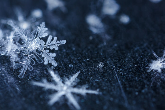 Snowflakes floating in a dusty space.