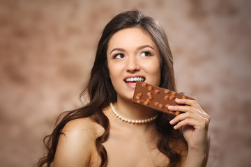Portrait of beautiful young woman with chocolate, close up