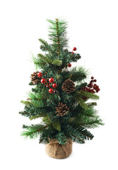 Small artificial Christmas tree isolated