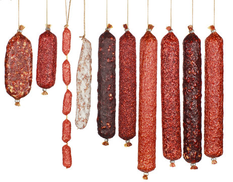 selection salami sausages isolated on white background