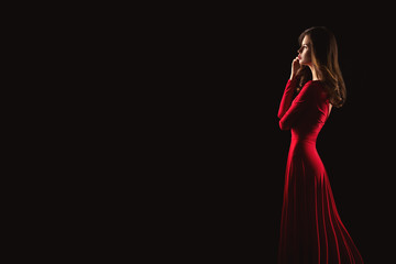 Portrait of young beautiful woman in red dress