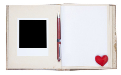 Photo album with photo frame, ballpoint and red heart