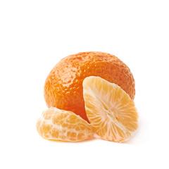 Whole tangerine next to peeled slices