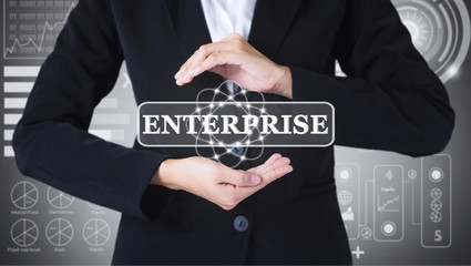Business women holding posts in ENTERPRISE. Can be used in advertising.