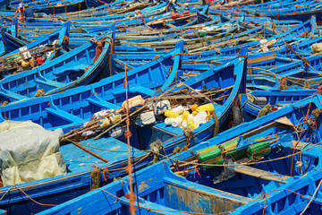 Blue fishing boats in the port of Essaouira, Morocco