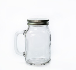 Empty jar with cap on white background