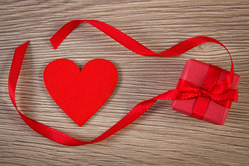 Wrapped gift with ribbon and heart for Valentines Day, copy space for text