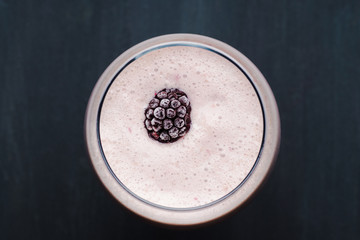 Blackberry smoothie on the wooden background