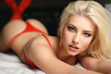 Beautiful blonde in a sexy red lingerie