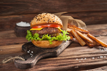 homemade burger on wooden background