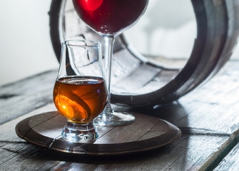 Two wineglasses and old barrel