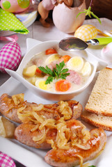 white borscht and roasted sausage on easter table