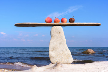 Apples in balance on stone