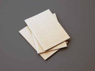 Set of golden color notebooks on the gray background. 3d render