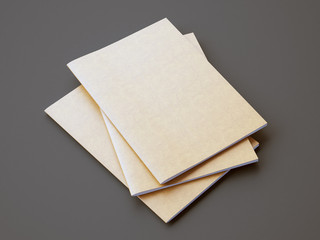 Set of golden color notebooks on the gray background. Horizontal. 3d render