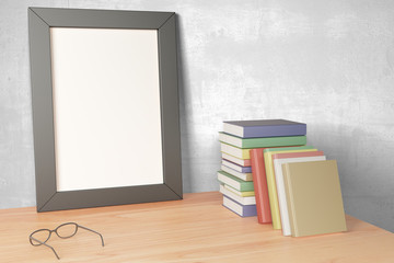 Blank grey picture frame on wooden table with eyeglasses and pil