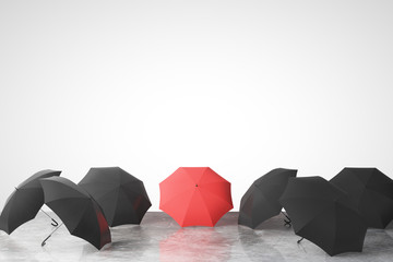 To be unique concept with many black umbrellas and one red on co