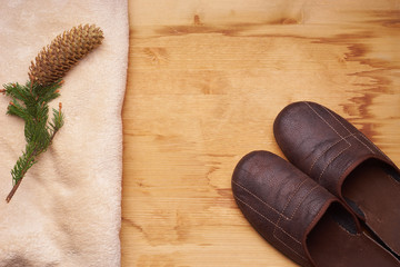 slippers on a wooden floor next to the knob