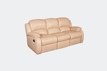 Light leather sofa on a gray background in the studio