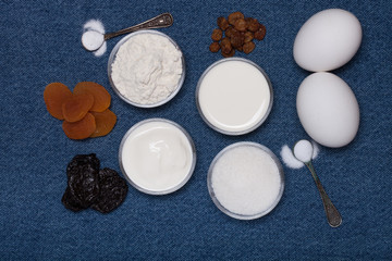 Ingredients for sweet pastry on a blue jeans background