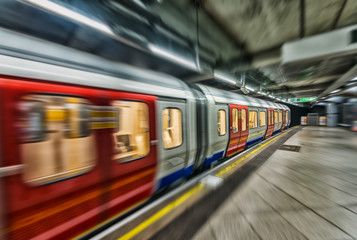 Fast moving subway train in London underground station