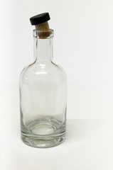 An empty glass bottle with cork