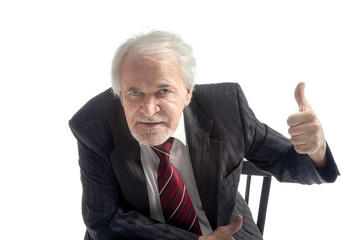 Smiling senior businessman with thumbs up
