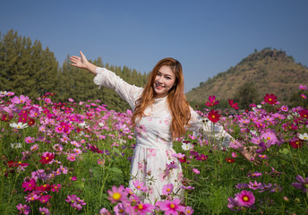 woman with cosmos flower field
