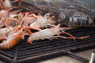 Grilled shrimps seafood by fire and BBQ Flames