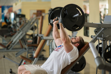 Athlete working out in gym.