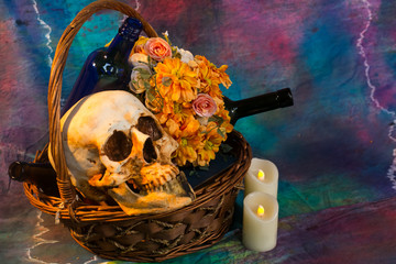 Skull with flowers and wine.