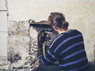 Young woman examinig fireplace