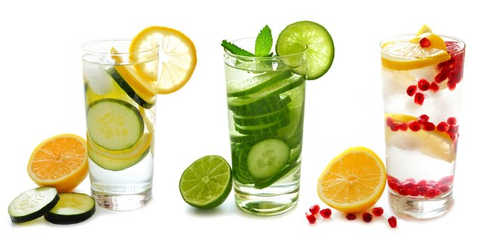 Three types of detox water with fruit in glasses isolated on a white background