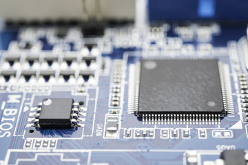 Computer chip on blue circuit motherboard