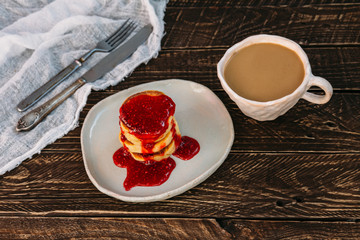 Coffee with milk and pancakes, Coffee with milk , pancakes with jam, clay dishes, strawberry jam.